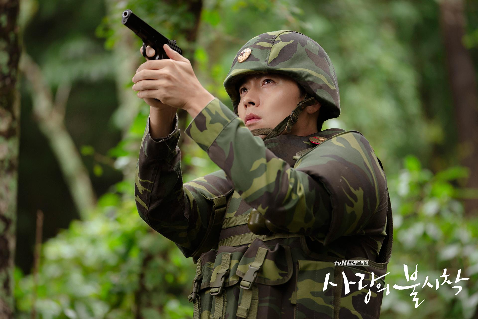 Crash Landing on You Captain Ri Jeong-hyeok pointing his gun at Yoon Se-ri