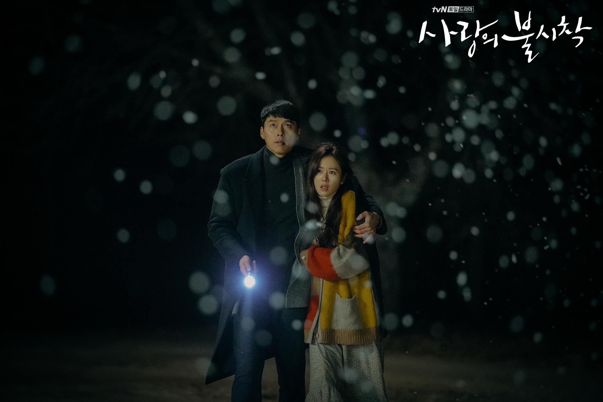 Crash Landing on You Captain Ri Jeong-hyeok and Yoon Se-ri walking in the snow episode 8