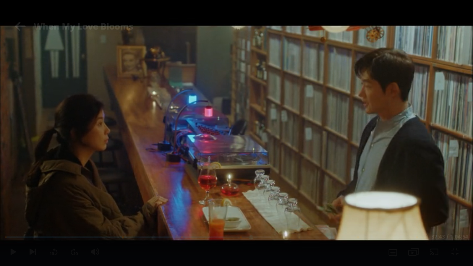 When My Love Blooms Episode 2 Yoon Ji-soo and Joo Young-woo drinking in LP Music Cafe